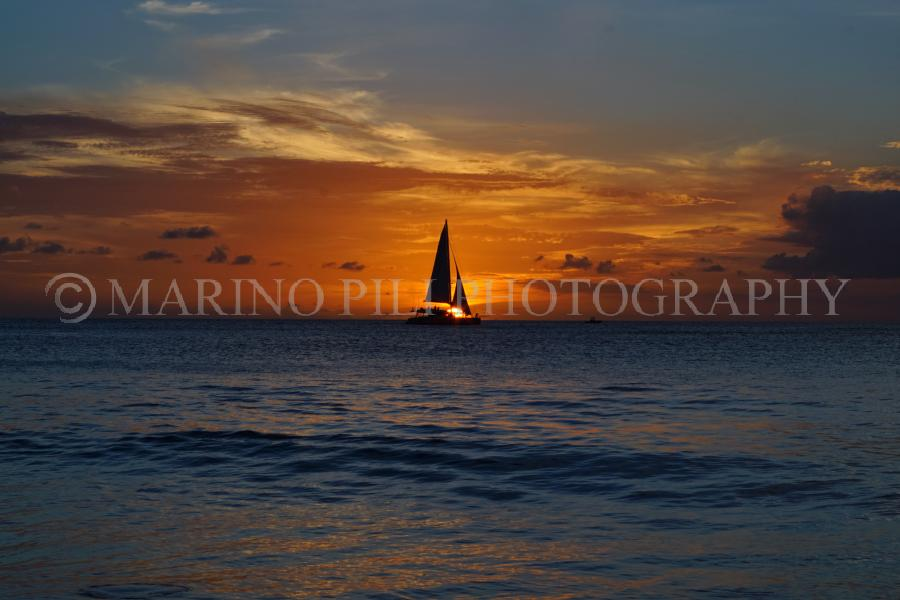 Sunset and sailing boat silhouette